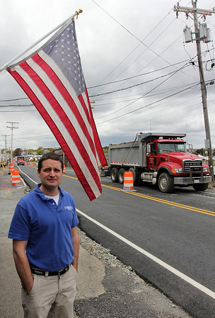 """Eian Woodman, assistant manager of Woodman's Restaurant in Essex, is happy that the Causeway has become """"a real road again."""" The road, which has been under construction, was paved this week. Photo by Kate Glass/Gloucester Daily Times"""
