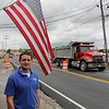 "Eian Woodman, assistant manager of Woodman's Restaurant in Essex, is happy that the Causeway has become ""a real road again."" The road, which has been under construction, was paved this week. Photo by Kate Glass/Gloucester Daily Times"