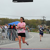 Gloucester: Gloucester's Kitie Taormina crosses the finish in the Twin Lights Half Marathon placing second for the woman with a time of 1:28:57 Sunday morning. Katie is Lacey Alves tranning partner who placed first. Desi Smith/Gloucester Daily Times.