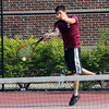 Chase Kelly returns a serve as Gloucester plays Malden Catholic yesterday at Gloucester High School. Photo by Kate Glass/Gloucester Daily Times