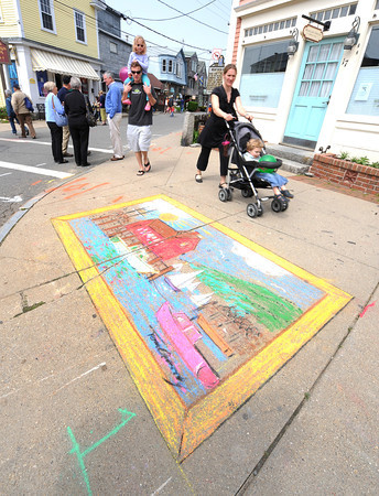 Rockport: Visitors look at a chaulk drawing of the Motif#1 drawn by Tom Garrity of Rockport, as they pass Dock Sq, Saturday afternoon at Motif#1 Celebration Day.  Desi Smith/Gloucester Daily Times.