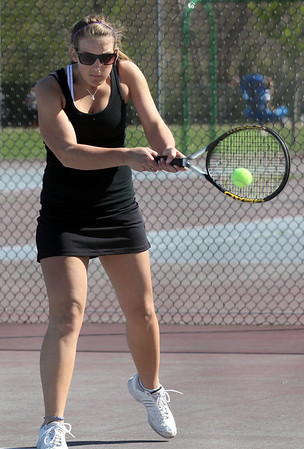 Rockport's Emma Littlefield hits a backhand during their match against Hamilton-Wenham yesterday. Photo by Kate Glass/Gloucester Daily Times
