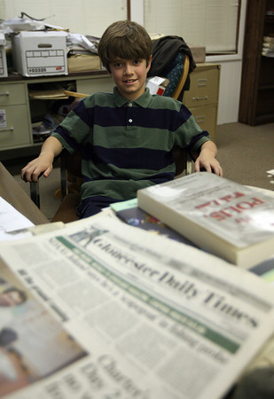 "Brandon Smith, a 4th grade student at West Parish Elementary School, sits in as ""Editor for a Day"" at the Gloucester Daily Times. Brandon and his mom, Laurie, won the role through the West Parish PTO Benefit Auction."