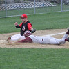 Rockport Jason Hendy slides safely into third base as Amesbury's Matt Enaire can't make the tag at Evan's Field yesterday. Photo by Kate Glass/Gloucester Daily Times