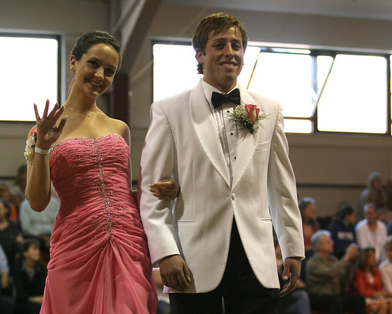 Rockport: Monica Napolitano waves to friends while walking the carpet with her prom date, David Peters, during the Rockport High School Promenade last night. The prom was held at Endicott College's Tuppor Manor. Photo by Kate Glass/Gloucester Daily Times