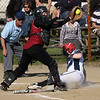 Gloucester's Ellie Williams reaches for the ball as Peabody's Holly Smith slides safely into home plate at Burnham Field yesterday. Photo by Kate Glass/Gloucester Daily Times