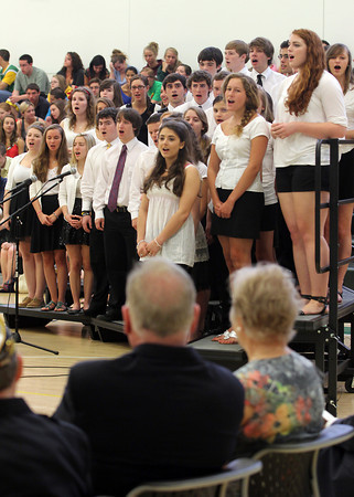 "Members of the Manchester Essex High School Chorus sing ""When Irish Eyes are Smiling"" for former Boston Mayor Ray Flynn during their Memorial Day assembly on Friday. Flynn was the guest speaker at the event. Photo by Kate Glass/Gloucester Daily Times"