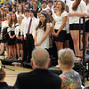 """Members of the Manchester Essex High School Chorus sing """"When Irish Eyes are Smiling"""" for former Boston Mayor Ray Flynn during their Memorial Day assembly on Friday. Flynn was the guest speaker at the event. Photo by Kate Glass/Gloucester Daily Times"""