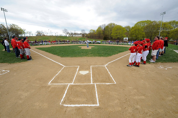 Gloucester:  Little Leauge co- president Dean Murray cener says a few words to players and fans durring opening day at Boudreau Field Saturday<br /> morning. Desi Smith/Gloucester Daily Times.