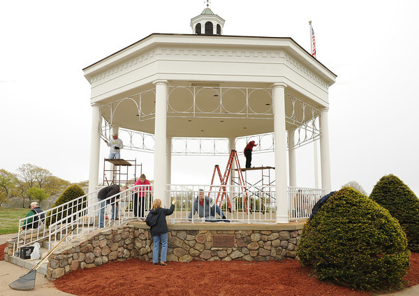 Gloucester: Volunteer's and Roatry Club members paint the Tony Gentle Memorial Bandstand  Saturday morning at Stage Fort Park.  Desi Smith/Gloucester Daily Times.