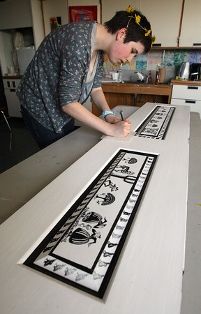 Gloucester: Zoe Morris, an honors art student at Gloucester High School, paints a door inspired by Virginia Lee Burton, which will be auctioned at the Gloucester Public School District Citywide Arts Festival, which is this Saturday. Photo by Kate Glass/Gloucester Daily Times