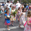 Flower girls carry bouquets to decorate the unmarked grave at Beech Grove Cemetery in Rockport during the town's Memorial Day ceremony yesterday. Photo by Gail McCarthy/Gloucester Daily Times