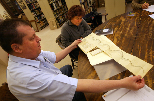"Gloucester: Wayne Soini, who wrote the book, ""Gloucester's Sea Serpent,"" shows a drawing of the serpent to Elizabeth Burns, who is writing her dissertation on the Gloucester sea serpent, while at the Cape Ann Museum yesterday. Photo by Kate Glass/Gloucester Daily Times"