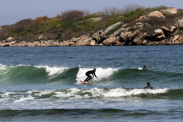 The surfers came out with the sun yesterday afternoon to ride the waves at Good Harbor Beach. Photo by Kate Glass/Gloucester Daily Times