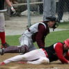 Rockport catcher Jay Fulmer gets the ball a hair late as Amesbury's Matt Short scores at Evan's Field yesterday. Photo by Kate Glass/Gloucester Daily Times