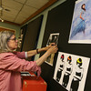 Gloucester: Sukey Hyde, who teaches photography at Gloucester High School, hangs her students' work at the Sawyer Free Library yesterday afternoon in preparation for the Gloucester Public School District Citywide Arts Festival, which is this Saturday. Photo by Kate Glass/Gloucester Daily Times