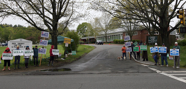 A dozen people lined the entrance to Manchester Memorial School yesterday to show support for their candidates during the election. Photo by Kate Glass/Gloucester Daily Times