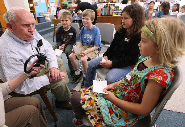 Manchester: Jerry Noonan shares stories about what Manchester was like when he was a kid with Memorial School third graders Thomas Birkeland, Spencer Meek, Sophia Pallazola, and Mia Cromwell as they record a Podcast  for their social studies unit on their community. Photo by Kate Glass/Gloucester Daily Times