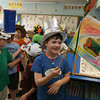 "Essex: Kai Carroll, a student in Elizabeth Kelley's first grade class at Essex Elementary School, waves his flag while getting ready for the annual Emperors' Parade on Friday. First graders studied various versions of Hans Christian Andersen's ""The Emperor's New Clothes"" and paraded through the school to show off their crowns and flags. Photo by Kate Glass/Gloucester Daily Times"