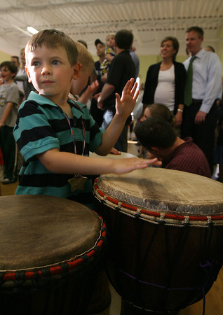 Essex: Landon Holland tries his hand at the drums during Art Night at Lil' Sprouts of Essex on Tuesday. Students and their families got to experience a variety of arts including martial arts, opera, and percussion. Photo by Kate Glass/Gloucester Daily Times