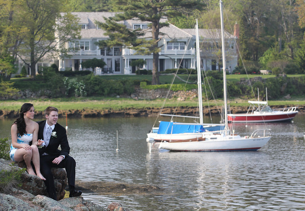 Manchester: Meghan Mason and Trevor Attridge take a break from posing for pictures at Tuck's Point before heading to the Manchester Essex High School prom at the New England Aquarium last night. Photo by Kate Glass/Gloucester Daily Times