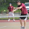 Gloucester: John Perry plays at the net while playing a doubles match with Matt Martin against Malden Catholic at Gloucester High School yesterday. Photo by Kate Glass/Gloucester Daily Times