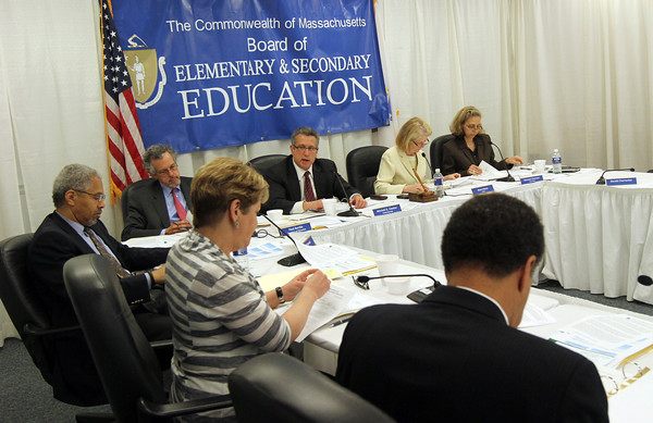 Mitchell Chester, Commissioner of Elementary and Secondary Education, center, recommends keeping the Charter School open, but with several conditions, during a meeting on Tuesday. Photo by Kate Glass/Gloucester Daily Times