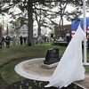 Magnolia: A craine unveils the new memorial honoring all service branche's Saturday morning in Knowlton Park in Magnolia.  Desi Smith/Gloucester Daily Times.