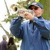 Magnolia: Jerry Silveria blows taps at the unveiling ceremony in Knowlton Park in Magnolia,honoring all service branches Saturday morning  Desi Smith/Gloucester Daily Times.