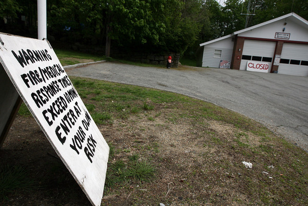 "The Bayview Fire Station has been closed most of the time lately, prompting one resident to place a sign reading ""Warning. Fire/Medical response times exceed 10 min. Enter at your own risk."" Photo by Kate Glass/Gloucester Daily Times"