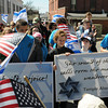 Gloucester: Congregation members from the Temple Ahavat Achim, parade up Center Street to their new place of worship on Middle Street Sunday morning. Desi Smith/Gloucester Daily Times.
