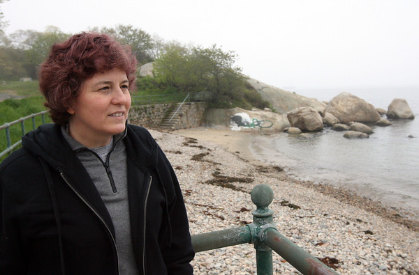 Gloucester: Elizabeth Burns, who is writing her dissertation on the Gloucester sea serpent, looks out over Cressy's Beach while visiting Gloucester for research. Photo by Kate Glass/Gloucester Daily Times