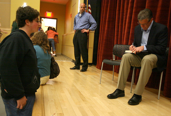 "Manchester: Steve Buckley, a sports columnist with the Boston Herald and radio talk show host on WEEI, signs a copy of his book, ""Wicked Good Year,"" for Manchester Essex sophomore Ben Shopper following a talk with students about sports and coming out as a gay man earlier this year. The talk was organized by Manchester's HEART Foundation. Photo by Kate Glass/Gloucester Daily Times"