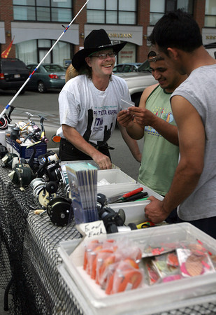 Gloucester: Howard Rafiel Johnson ,who runs Raf's Bait Wagon, is back at the intersection of Commercial and Washington Street, though his vending spot was moved to the space directly in front of St. Peter's Square.  Photo by Kate Glass/Gloucester Daily Times