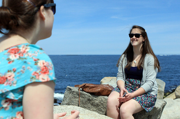 DAVID LE/Gloucester Times. Susan Malone, right, of Saugus chats with her friend Caroline Hanley, left, of Wakefield in downtown Rockport on a beautiful May afternoon. 5/13/11.