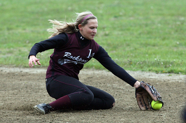 Rockport's Amanda Chalmers slides across the infield to block the ball during their game against North Andover yesterday. Photo by Kate Glass/Gloucester Daily Times