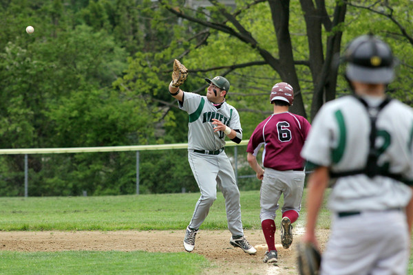 Essex: Manchester Essex's Max Nesbit reaches for the ball to get Rockport's Rob Nelson out at first base yesterday. Photo by Kate Glass/Gloucester Daily Times