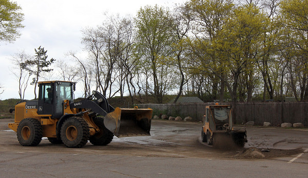 Manchester: A crew from the Manchester Department of Public Works cleans the parking lot at Singing Beach yesterday after the remaining snow was removed from the lot to prepare for the summer season. Photo by Kate Glass/Gloucester Daily Times