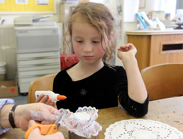 Essex: Katahdin Gould, 5, works on a craft at the T.O.H.P Burnham Library last week. The library will be holding its Pie Fest fundraiser today starting at 2pm. Photo by Kate Glass/Gloucester Daily Times
