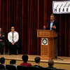 Manchester Essex Vice Principal Paul Murphy and former student Greg Kimball listen as Boston sports writer and radio talk show host Steve Buckley speaks to students about coming out as a gay man earlier this year. Photo by Kate Glass/Gloucester Daily Times