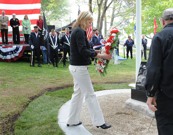 Magnolia:  Cathie Hull goes to lay a wreath at the new memorial honoring her father Harding Hull who served in the Air Force and all other service branches, who served this country, Saturday morning at the unveiling and ceremony in Knowlton Park in Magnolia.  Desi Smith/Gloucester Daily Times.