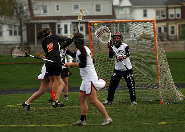Beverly's Camden Vitale gets the ball past Gloucester goalie Molly Blewett during their game at Newell Stadium. Photo by Kate Glass/Gloucester Daily Times