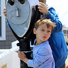 DAVID LE/Gloucester Times. Hudson Newman, 4, front, enjoys a beautiful May day as his brother Caleb, 10, peers through binoculars out at the ocean on Friday afternoon. 5/13/11.