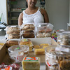 Beatriz Torres stands behind several popular baked goods at Miguel's Grocery Store on Maplewood Avenue. The bodega opened earlier this month. Photo by Kate Glass/Gloucester Daily Times