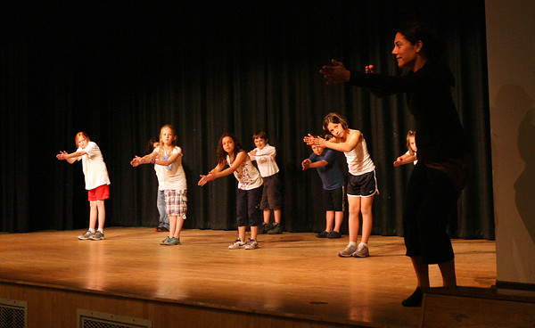 Rockport: Students in Phil Whitley's third grade class at Rockport Elementary School mimic the movements of Weber Dance instructor Kristy Kuhn during a recital at the school on Thursday. The students learned about various aspects of choreography duirng a four week program sponsored by the Education Foundation of Rockport. Photo by Kate Glass/Gloucester Daily Times