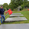 ALLEGRA BOVERMAN/Staff photo. Gloucester Daily Times. Gloucester: Gloucester Firefighters Mike Chipperini and Tony Trupiano at the Firefighters Memorial at the Cherry Hill Cemetery on Tuesday morning. Flags were placed at gravesites throughout the city's cemeteries on Tuesday in preparation for both Memorial Day, because many firefighters also were veterans, but also for the upcmoing Firefighters Memorial Service to be held at 8:45 a.m. on Sunday, June 10. A parade will step off from the Department of Public Works on Poplar Street and make its way to Cherry Hill Cemetery to the Firefighters Memorial. If it rains, the ceremony will be held at the fire department's headquarters.