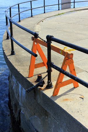 ALLEGRA BOVERMAN/Staff photo. Gloucester Daily Times. Gloucester: The seawall in the vicinity of Blynman Bridge at Stacy Boulevard is crumbling in many areas. The railing is also in need of repair.