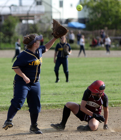 ALLEGRA BOVERMAN/Staff photo. Gloucester Daily Times. Gloucester: Gloucester's Claire Pleuler is safe on second base during their game against Lynnfield in Gloucester on Friday afternoon. Gloucester beat Lynnfield 6-5. Lynnfield's Katie Rowe is on second base.
