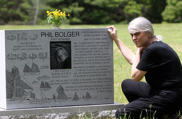 ALLEGRA BOVERMAN/Staff photo. Gloucester Daily Times. Gloucester: Susanne Altenburger at the gravesite of her husband, Phil Bolger, at Doliver's Memorial Cemetery on Wednesday. Thursday is three years since his passing.