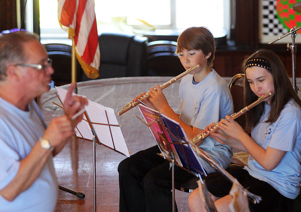 Jesse Poole/Gloucester Daily Times May 12, 2012 GLOUCESTER— With David Benjamin conducting the band, Owen Brown, 13, and Ericca Nolan, 11, play the eerie theme from the Harry Potter movie series on their flutes at City Hall on Saturday afternoon as part of the city's art festival featuring art from students and others as well.